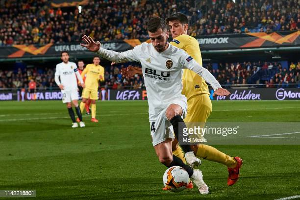 Jose Gaya of Valencia CF competes for the ball with Gerard Moreno of Villarreal CF during the UEFA Europa League Quarter Final First Leg match...