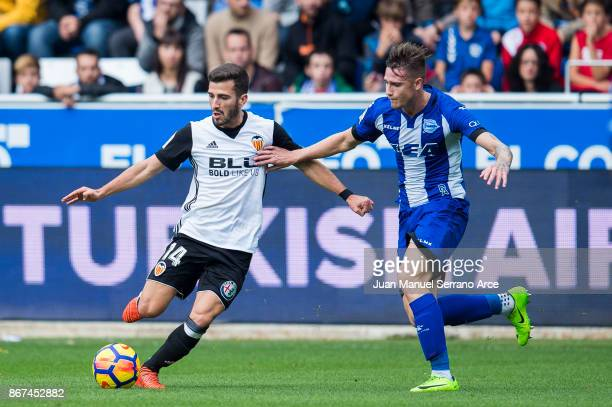 Jose Gaya of Valencia CF duels for the ball with Munir El Haddadi of Deportivo Alaves during the La Liga match between Deportivo Alaves and Valencia...