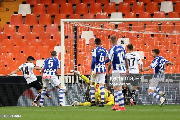 Jose Gaya of Valencia CF scores their sides first goal whilst under pressure from Victor Laguardia of Deportivo Alaves during the La Liga Santander...