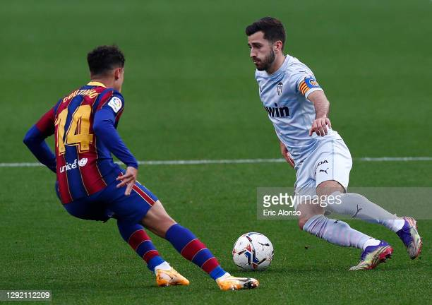 Jose Gaya of Valencia CF takes on Philippe Coutinho of FC Barcelona during the La Liga Santander match between FC Barcelona and Valencia CF at Camp...