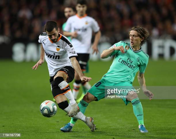 Jose Gaya of Valencia competes for the ball with Luka Modric of Real Madrid during the Liga match between Valencia CF and Real Madrid CF at Estadio...