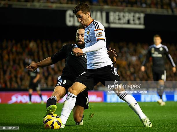 Jose Gaya of Valencia is tackled by Carvajal of Real Madrid during the La Liga match between Valencia CF and Real Madrid CF at Estadi de Mestalla on...
