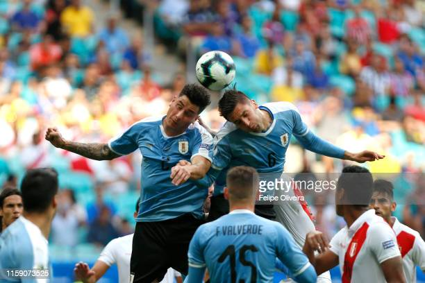 Jose Gimenez and Rodrigo Bentancur of Uruguay head the ball during the Copa America Brazil 2019 quarterfinal match between Uruguay and Peru at Arena...