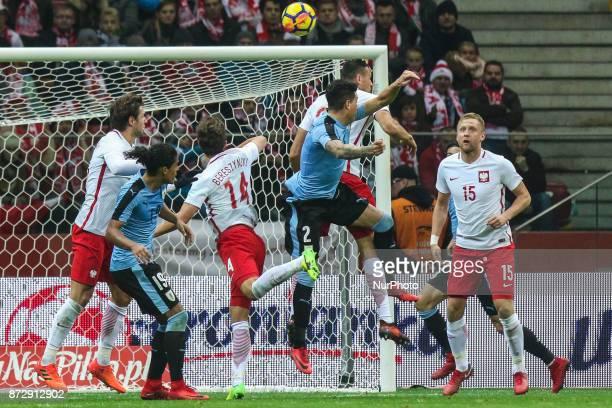 Jose Gimenez Mauricio Lemos Bartosz Bereszynski Kamil Glik Jakub Swierczok in action during the international friendly match between Poland and...