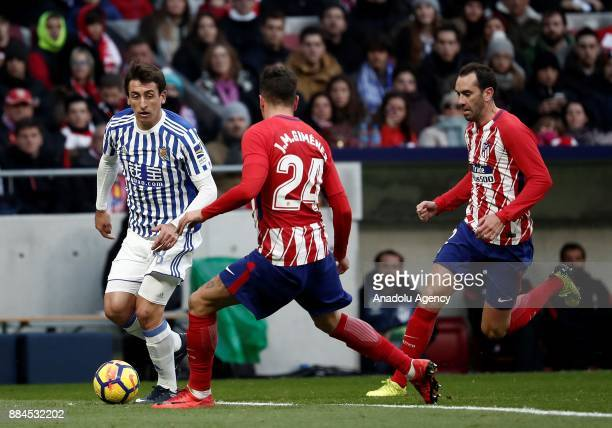 Jose Gimenez of Atletico de Madrid in action against Mikel Oyarzabal of Real Sociedad during the La Liga match between Club Atletico Madrid and Real...