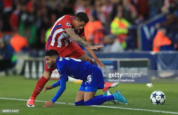 Jose Gimenez of Atletico Madrid and Riyad Mahrez of Leicester City battle for possession during the UEFA Champions League Quarter Final second leg...