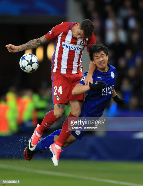 Jose Gimenez of Atletico Madrid and Shinji Okazaki of Leicester City battle to win a header during the UEFA Champions League Quarter Final second leg...