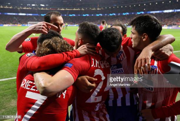 Jose Gimenez of Atletico Madrid celebrates with teammates after scoring his team's first goal during the UEFA Champions League Round of 16 First Leg...