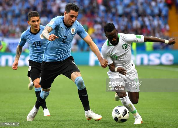Jose Gimenez of Uruguay battles for possession with Fahad Almuwallad of Saudi Arabia during the 2018 FIFA World Cup Russia group A match between...