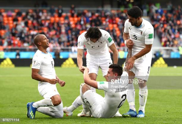Jose Gimenez of Uruguay celebrates after scoring his team's first goal with team mates during the 2018 FIFA World Cup Russia group A match between...