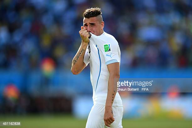 Jose Gimenez of Uruguay celebrates the 10 win in the 2014 FIFA World Cup Brazil Group D match between Italy and Uruguay at Estadio das Dunas on June...