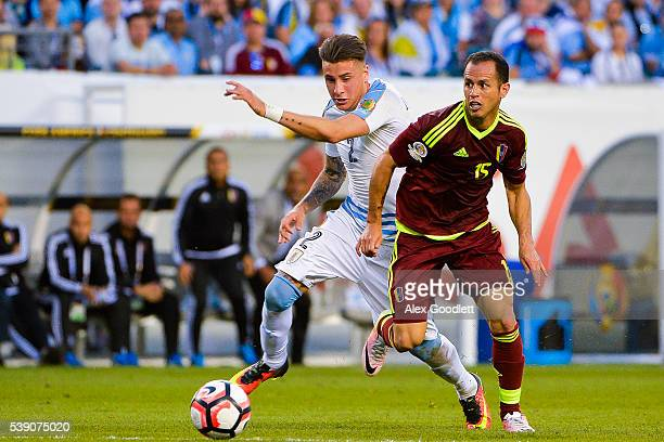 Jose Gimenez of Uruguay fights for the ball with Alejandro Guerra of Venezuela during a group C match between Uruguay and Venezuela at Lincoln...