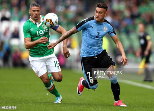 Jose Gimenez of Uruguay is put under pressure from Jonathan Walters of the Republic of Ireland during the International Friendly match between...