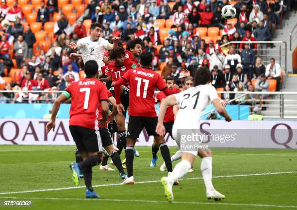 Jose Gimenez of Uruguay shoots and scores his side's first goal during the 2018 FIFA World Cup Russia group A match between Egypt and Uruguay at...