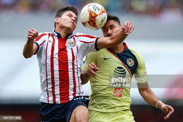 Jose Godinez of Chivas struggles for the ball with Bruno Valdez of America during the 11th round match between America and Chivas as part of the...
