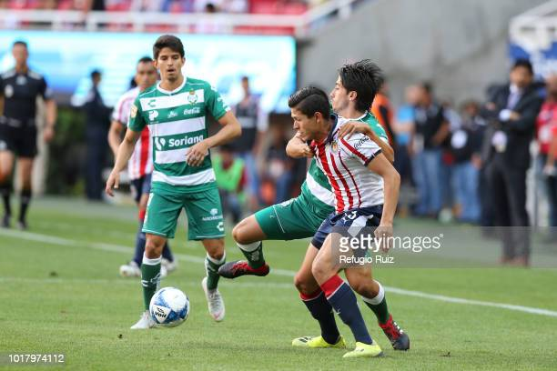 Jose Godínez of Chivas fights for the ball with Jose Abella of Santos during the fourth round match between Chivas and Santos Laguna as part of the...