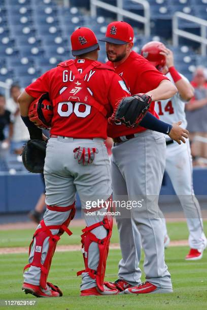 Jose Godoy congratulates Dominic Leone of the St Louis Cardinals after the final out against the Washington Nationals in a spring training game at...