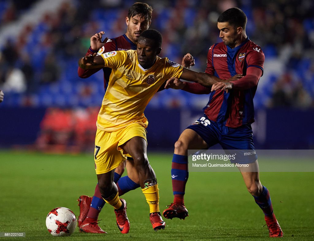 Jose Gomez Campana and Sergio Postigo (L) of Levante competes for the ball with Marlos Moreno of Girona during the Copa del Rey, Round of 32, Second Leg match between Levante and Girona at Ciudad de Valencia Stadium on November 28, 2017 in Valencia, Spain.