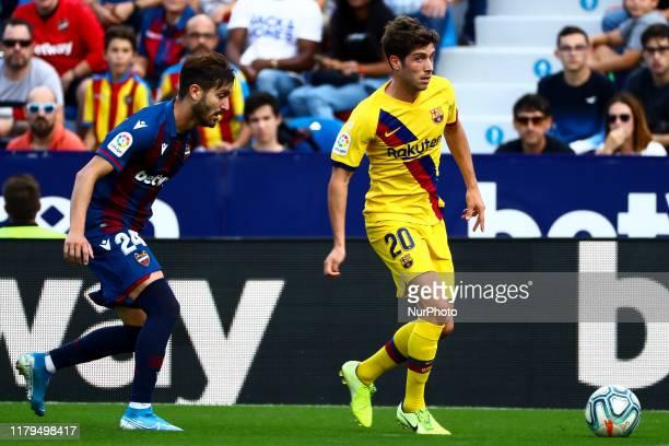 Jose Gomez Campana of Levante UD and FC Barcelona's defender Sergi Roberto during spanish La Liga match between Levante UD vs FC Barcelona at Ciutat...