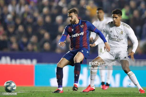 Jose Gomez Campana of Levante UD defens the ball against Raphael Varane of Real Madrid during the Liga match between Levante UD and Real Madrid CF at...