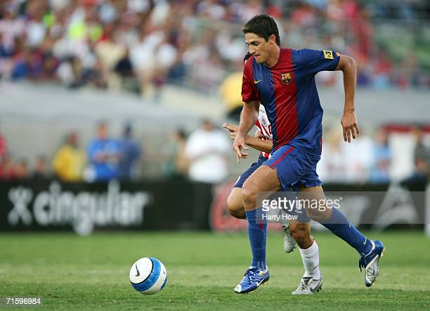 Jose Gomez Edmilson of Barcelona gets clear for a shot in front of Omar Bravo of Chivas Guadalajara during the second half at the Los Angeles...
