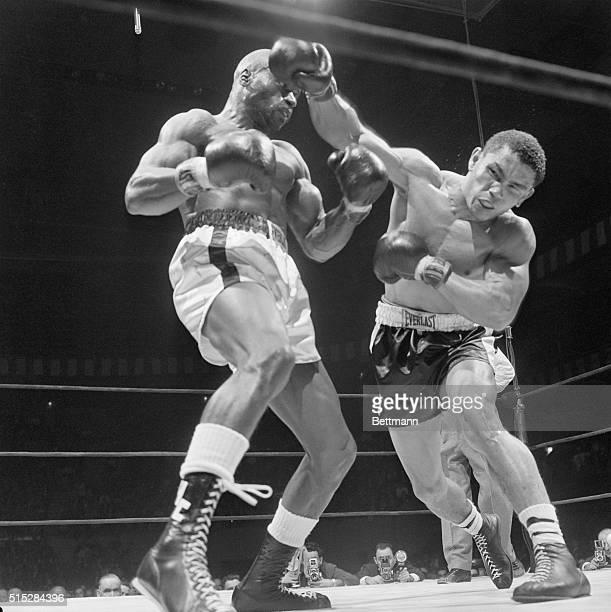 Jose Gonzales of Arroyo Puerto Rico whips a right to the head of Rubin Hurricane Carter of Paterson NJ during their middleweight bout at Madison...