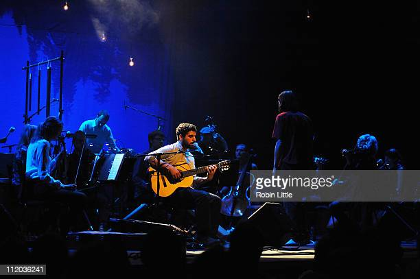 Jose Gonzalez performs on stage with the Gothenberg String Theory at Barbican Centre on April 11 2011 in London United Kingdom