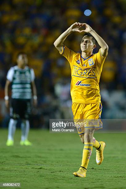 Jose 'Gringo' Torres of Tigres celebrates after scoring his team's second goal during a semifinal match between Tigres UANL and Santos Laguna as part...