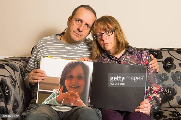 Jose Gross and Rosalind Hodgkiss the parents of missing teenager Alice Gross hold a picture of their daughter at their home in Hanwell on September...
