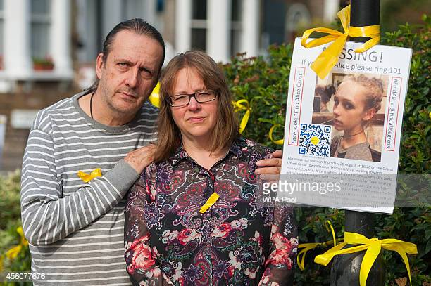 Jose Gross and Rosalind Hodgkiss the parents of missing teenager Alice Gross stand next to a poster appealing for information near their home in...