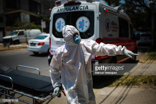 Jose Guadalupe paramedic of Nezahualcoyotl carries a stretcher during the answer to an emergency call of probable COVID19 on June 18 2020 in...