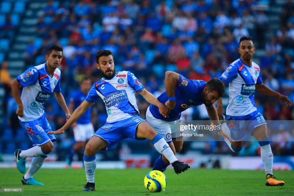 Jose Guerrero of Puebla struggles for the ball with Martin Cauteruccio of Cruz Azul during the 8th round match between Cruz Azul and Puebla as part of the Torneo Clausura 2018 Liga MX at Azul Stadium on February 17, 2018 in Mexico City, Mexico.