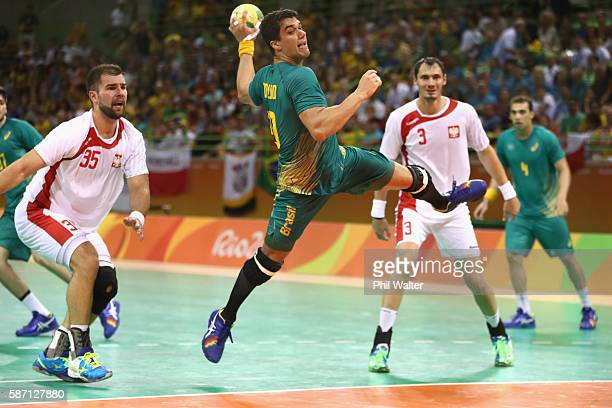 Jose Guilherme de Toledo of Brazil shoots during the Mens Preliminary Group B match between Poland and Brazil at the Future Arena on Day 2 of the Rio...