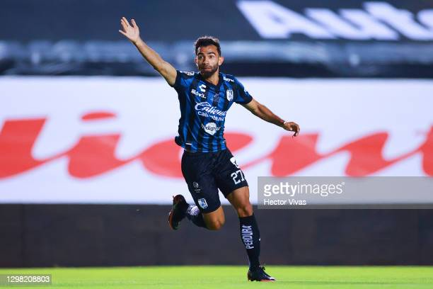 Jose Gurrola of Queretaro celebrates after scoring the first goal of his team during the 3rd round match between Queretaro and Pumas UNAM as part of...
