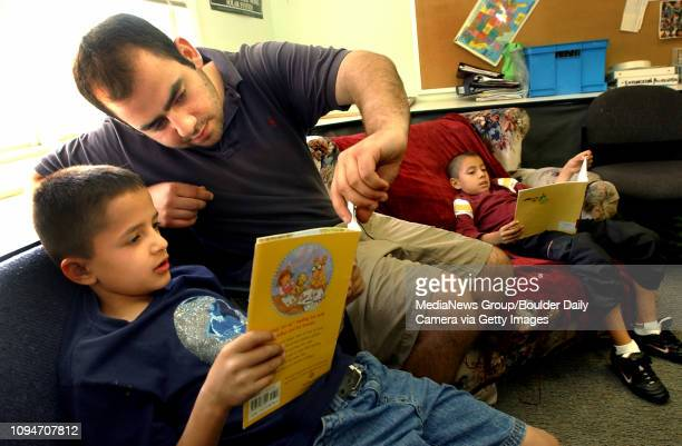 Jose Gutierrez age 8 reads to volunteer Matt Glander during the Family Learning Center's Elementary Afterschool Program in Boulder on September 22...