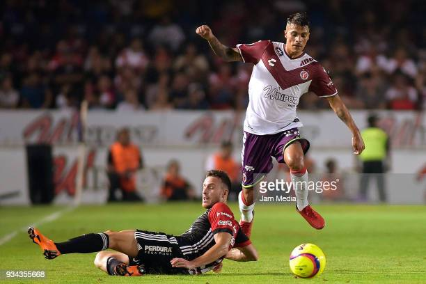 Jose Henriquez of Atlas and Richard Ruiz of Veracruz compete for the ball during the 12th round match between Veracruz and Atlas as part of the...