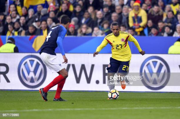 Jose Heriberto Izquierdo of Colombia runs with ball during the international friendly match between France and Colombia at Stade de France on March...