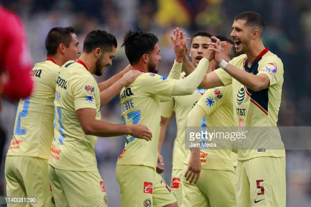 Jose Hernandez of America celebrates with teammates after scoring the first goal of his team during the match between America and Tijuana as part of...