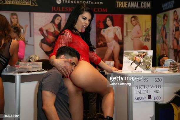 Jose Hernandez of California poses for photos with adult film actress Gina Valentina at the Jules Jordan Video booth during the 2018 AVN Adult Expo...