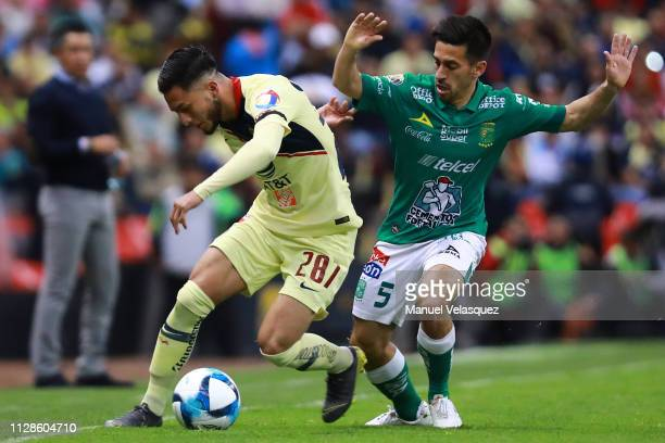 Jose Hernández of America struggles for the ball against Fernando Navarro of Leon during the 6th round match between America and Leon as part of the...