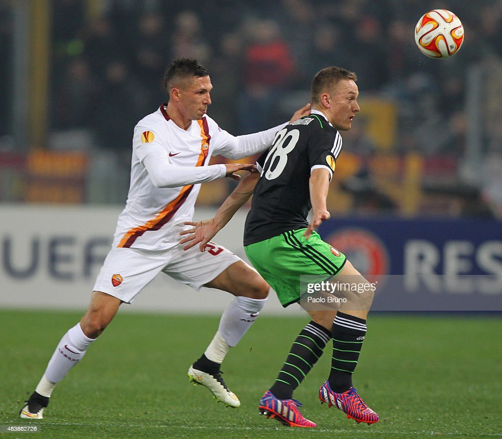 Jose' Holebas (L) of AS Roma competes for the ball with Jens Toornstra of Feyenoord during the UEFA Europa League Round of 32 match between AS Roma and Feyenoord at Olimpico Stadium on February 19, 2015 in Rome, Italy.