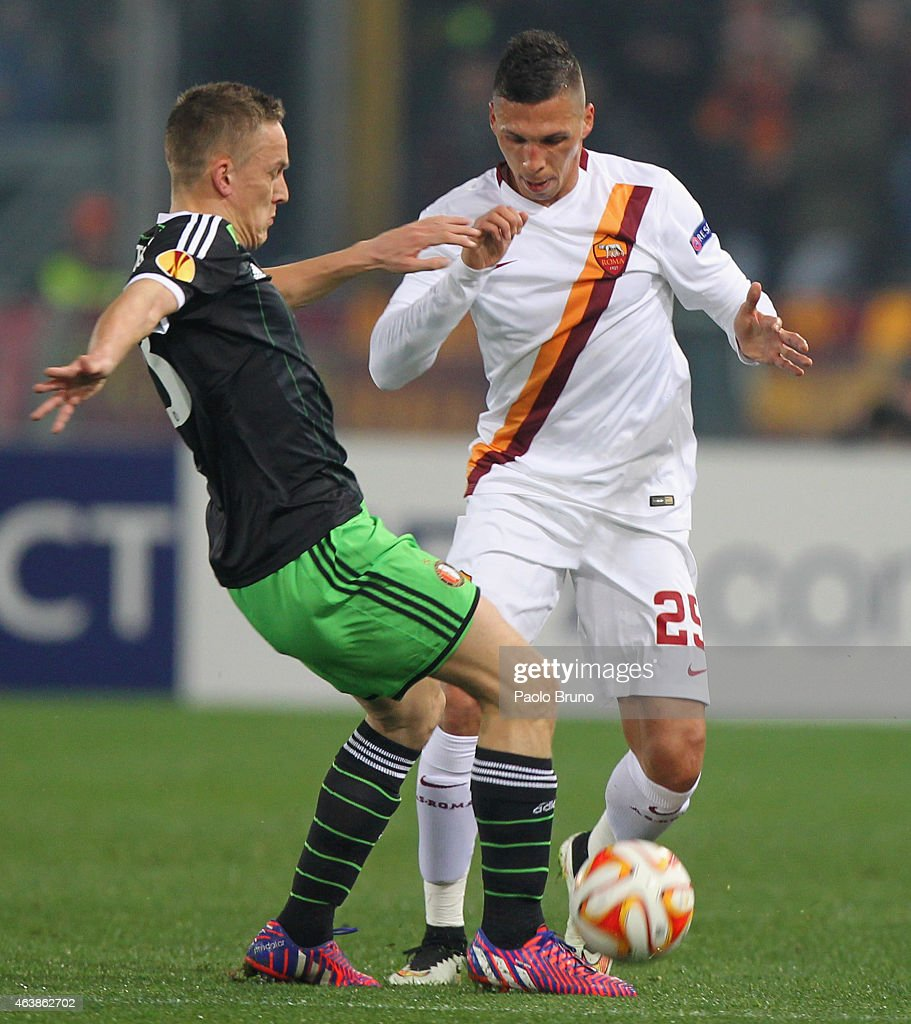 Jose' Holebas (R) of AS Roma competes for the ball with Jordy Clasie of Feyenoord during the UEFA Europa League Round of 32 match between AS Roma and Feyenoord at Olimpico Stadium on February 19, 2015 in Rome, Italy.