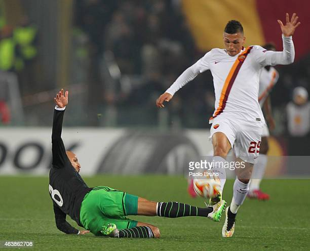 Jose' Holebas of AS Roma competes for the ball with Karim El Ahmadi of Feyenoord during the UEFA Europa League Round of 32 match between AS Roma and...