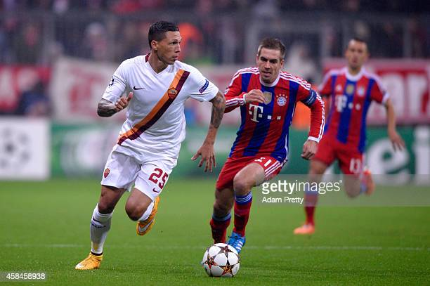 Jose Holebas of AS Roma is chased by Philipp Lahm of Bayern Muenchen during the UEFA Champions League Group E match between FC Bayern Munchen and AS...