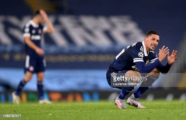 Jose Holebas of Olympiacos reacts at full-time during the UEFA Champions League Group C stage match between Manchester City and Olympiacos FC at...