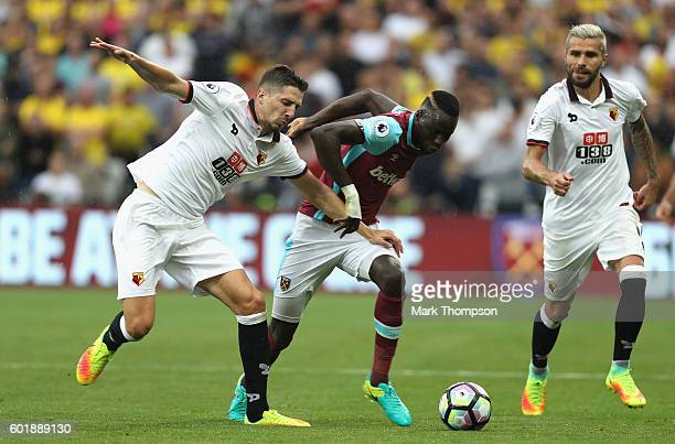 Jose Holebas of Watford and Cheikhou Kouyate of West Ham United battle for possession during the Premier League match between West Ham United and...