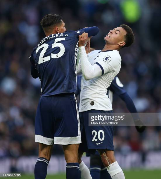 Jose Holebas of Watford and Dele Alli of Tottenham clash off the ball during the Premier League match between Tottenham Hotspur and Watford FC at...