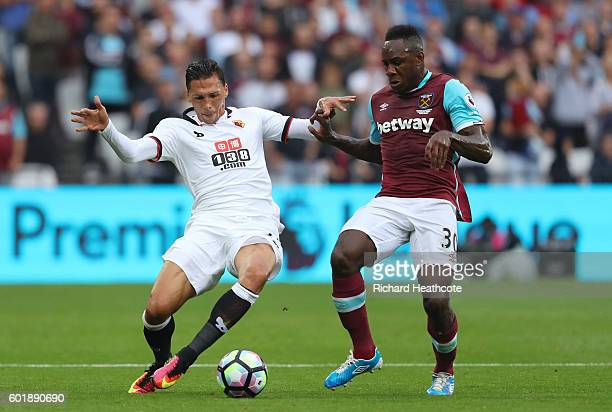 Jose Holebas of Watford and Michail Antonio of West Ham United battle for possession during the Premier League match between West Ham United and...
