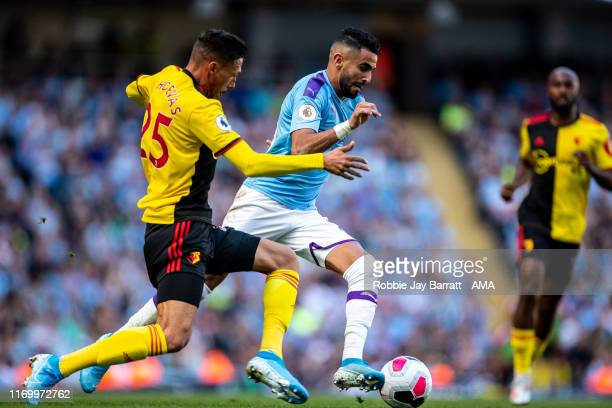 Jose Holebas of Watford and Riyad Mahrez of Manchester City during the Premier League match between Manchester City and Watford FC at Etihad Stadium...