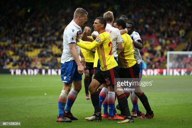 Jose Holebas of Watford and Ryan Shawcross of Stoke City clash during the Premier League match between Watford and Stoke City at Vicarage Road on...